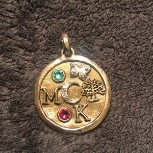 Large sterling silver and brass totem charm